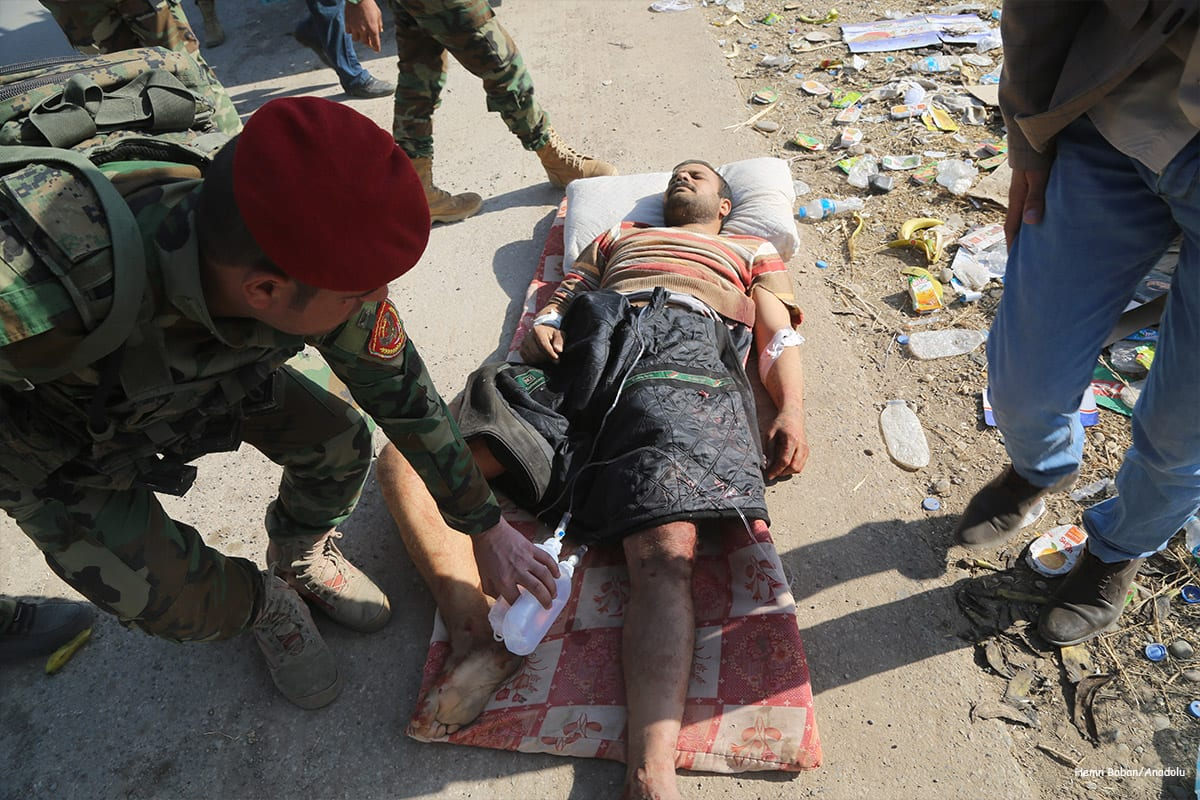 A wounded man is taken to hospital after clashes between Iraqi Kurdish Regional Government's peshmerga forces and Daesh terrorists in Mosul on November 17 2016 [Hemn Baban/Anadolu]
