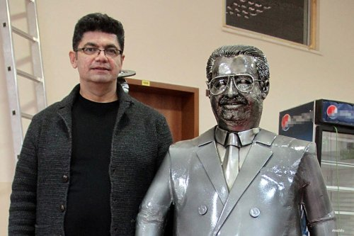 Turkish Professor Rochan Kijaji uses scrap metal to make figures of characters made famous through history or film including former Turkish President Turgut Ozal [Anadolu]