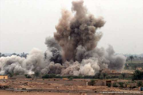 Image of an airstrike attack in Iraq carried out by the US [U.S. Marine Corps photo by Lance Cpl. James J. Vooris/Wikipedia]