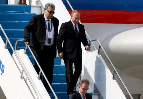 ISTANBUL, TURKEY: A file photo dated 10 October 2016 shows Russian President Vladimir Putin (R) being accompanied by Russian Ambassador to Turkey, Andrei Karlov (L) as he arrives in Istanbul. [İslam Yakut/Anadolu Agency]
