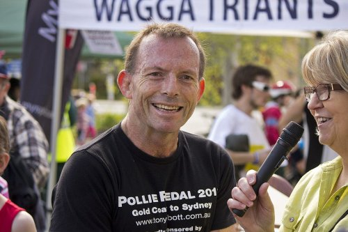Tony Abbott being interviewed by Master of Ceremonies, Leigh Spokes after completing the Lake to Lagoon in Wagga Wagga [Bidgee / Wikipedia]