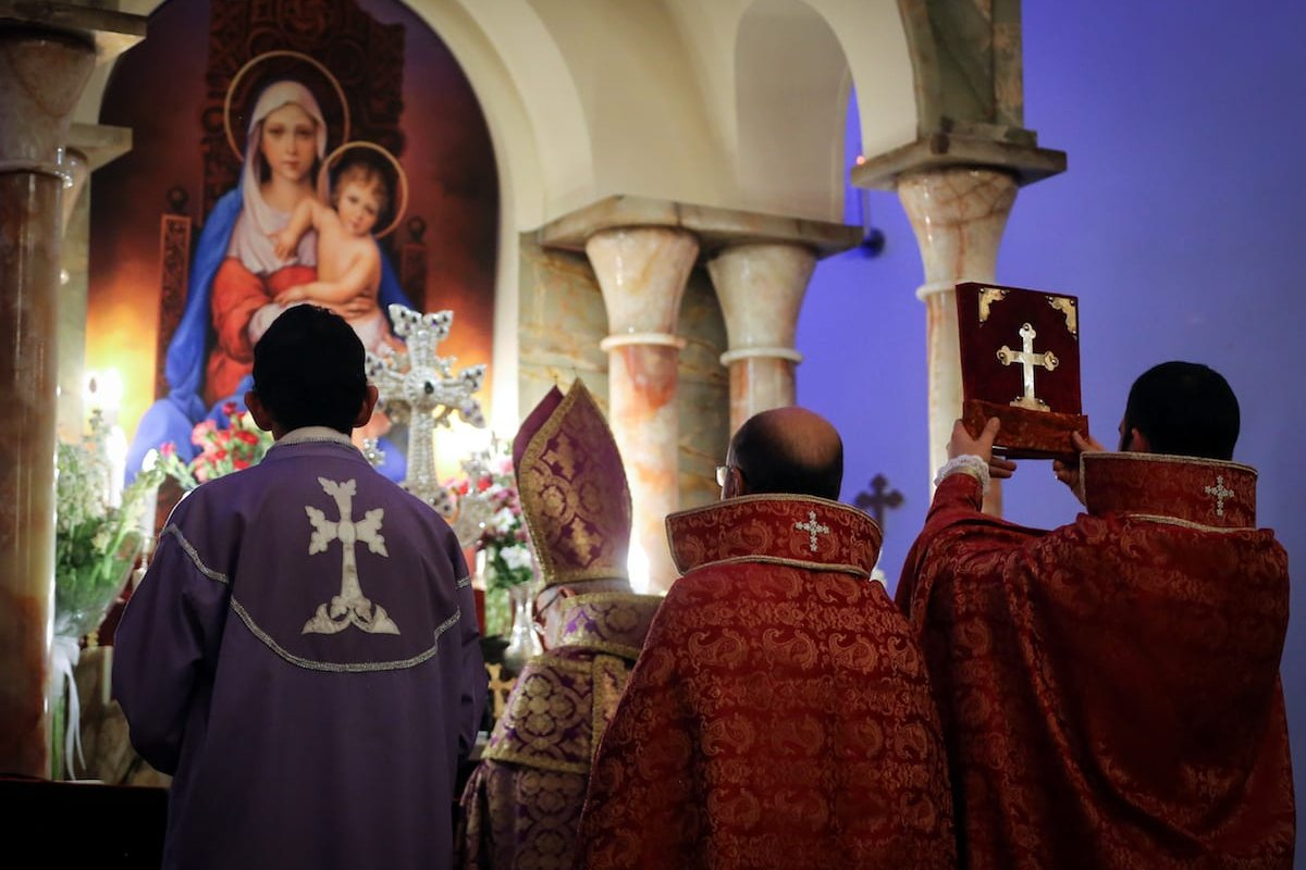 Armenians are seen during a New Year's mass at St. Sarkis Church on 1 January 2017 [Fatemeh Bahrami/Anadolu Agency]