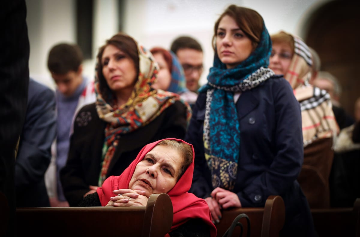 Armenians are seen during a New Year's mass at St. Sarkis Church in Tehran, Iran on 1 January, 2017 [Fatemeh Bahrami/Anadolu Agency]