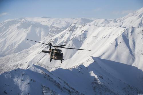 A military helicopter flies during an operation against PKK militants in Hakkari, Turkey on December 30, 2016 [Özkan Bilgin / Anadolu Agency]