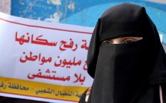 RAFAH, GAZA - JANUARY 3: A woman is seen as a group of protesters gather in front of en-Neccar Hospital demanding opening of a new hospital in Rafah, Gaza on January 3, 2017. ( Abed Rahim Khatib - Anadolu Agency )