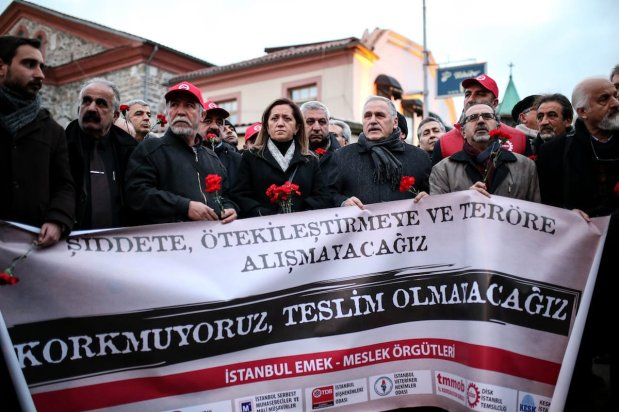ISTANBUL, TURKEY - JANUARY 3: A group of people hold a banner at site as they gather to pay tribute to the victims of Istanbul nightclub terror attack in Istanbul, Turkey on January 3, 2017. An armed terrorist attack killed at least 39 people and injured 69 -- four of them critically -- at an Istanbul nightclub during the new year celebrations on early hours of 1st of January, 2017. ( Berk Özkan - Anadolu Agency )