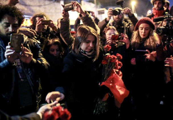 ISTANBUL, TURKEY - JANUARY 3: People leave carnations at site as they take part in a protest against Istanbul nightclub terror attack in Istanbul, Turkey on January 3, 2017. An armed terrorist attack killed at least 39 people and injured 69 -- four of them critically -- at an Istanbul nightclub during the new year celebrations on early hours of 1st of January, 2017. ( Berk Özkan - Anadolu Agency )
