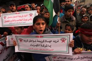 GAZA CITY, GAZA - JANUARY 03: Palestinians take part in a protest to demand a solution for power cuts at Al-Bureyc refugee camp of Gaza City, Gaza on January 03, 2017. ( Ahsraf Amra - Anadolu Agency )