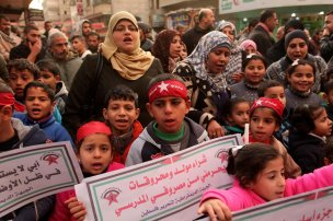 GAZA CITY, GAZA - JANUARY 03: Palestinians take part in a protest to demand a solution for power cuts at Al-Bureyc refugee camp of Gaza City, Gaza on January 03, 2017. ( Ahsraf Amra - Anadolu Agency )