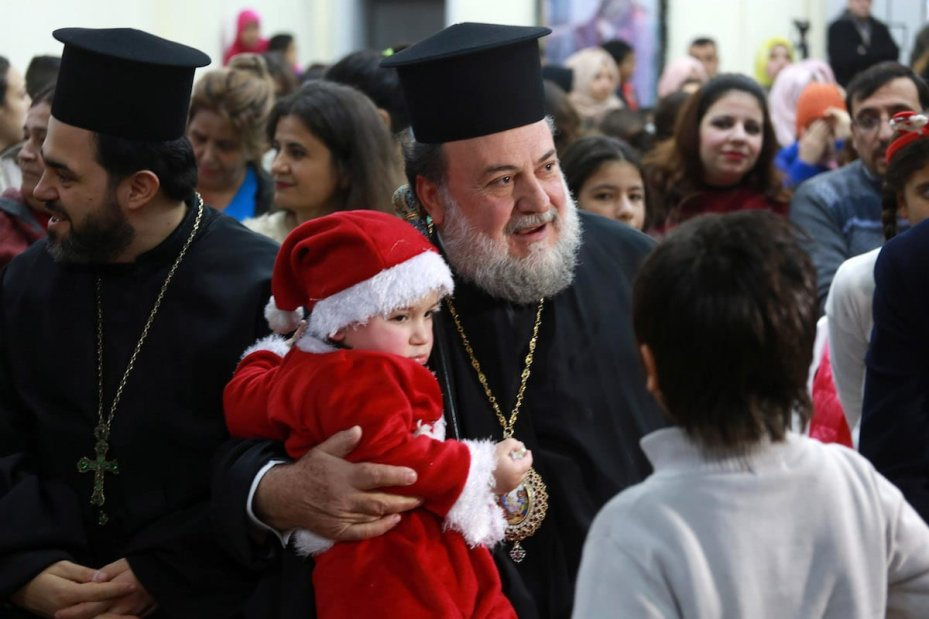 GAZA CITY, GAZA - JANUARY 5: Archbishop Alexios (R) attends a celebration within Christmas preparations in Gaza City, Gaza on January 5, 2017. Orthodox Christians will celebrate the Christmas on January 6 according to Julian Calendar. ( Mohammed Asad - Anadolu Agency )
