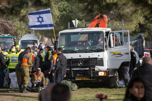 Officials examine the scene after a truck rammed into Israeli soldiers in Jerusalem on 8 January 2017 [Stringer/Anadolu Agency]