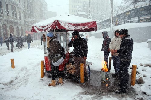 Peddlers are getting warmer with fire as heavy snowfall hits Istanbul, Turkey on January 9, 2017.