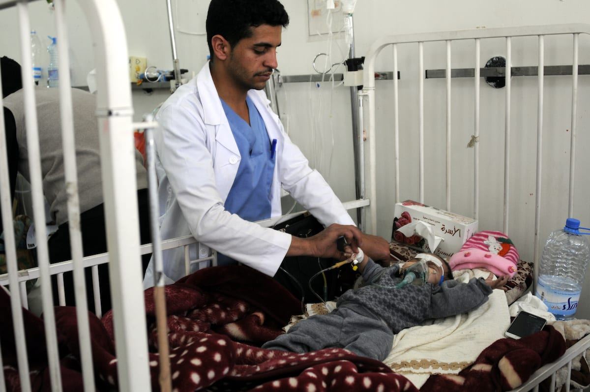 A doctor examines a baby at the Sabaeen hospital in Sanaa, Yemen on 18 January, 2017 [Mohammed Hamoud/Anadolu Agency]