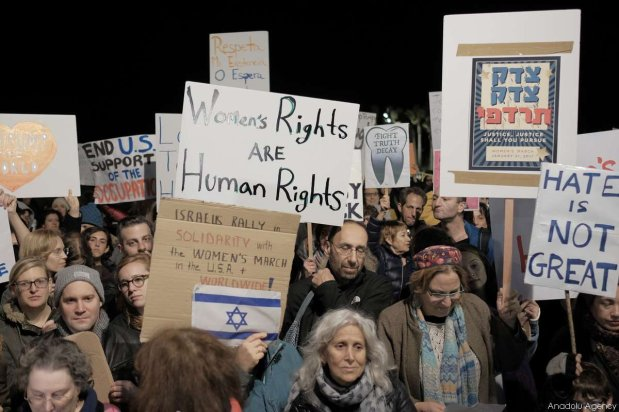 TEL AVIV, ISRAEL - JANUARY 21: Demonstrators hold banners and shout slogans during the protest in support of 'Women's March' parade against President Donald Trump at Washington, outside the US embassy in Tel Aviv, Israel on January 21, 2017. ( Tomer Neuberg - Anadolu Agency )