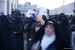 Shots from large artillery fire close by as women scramble for aid. [Ty Faruk/middleeastmonitor.com]