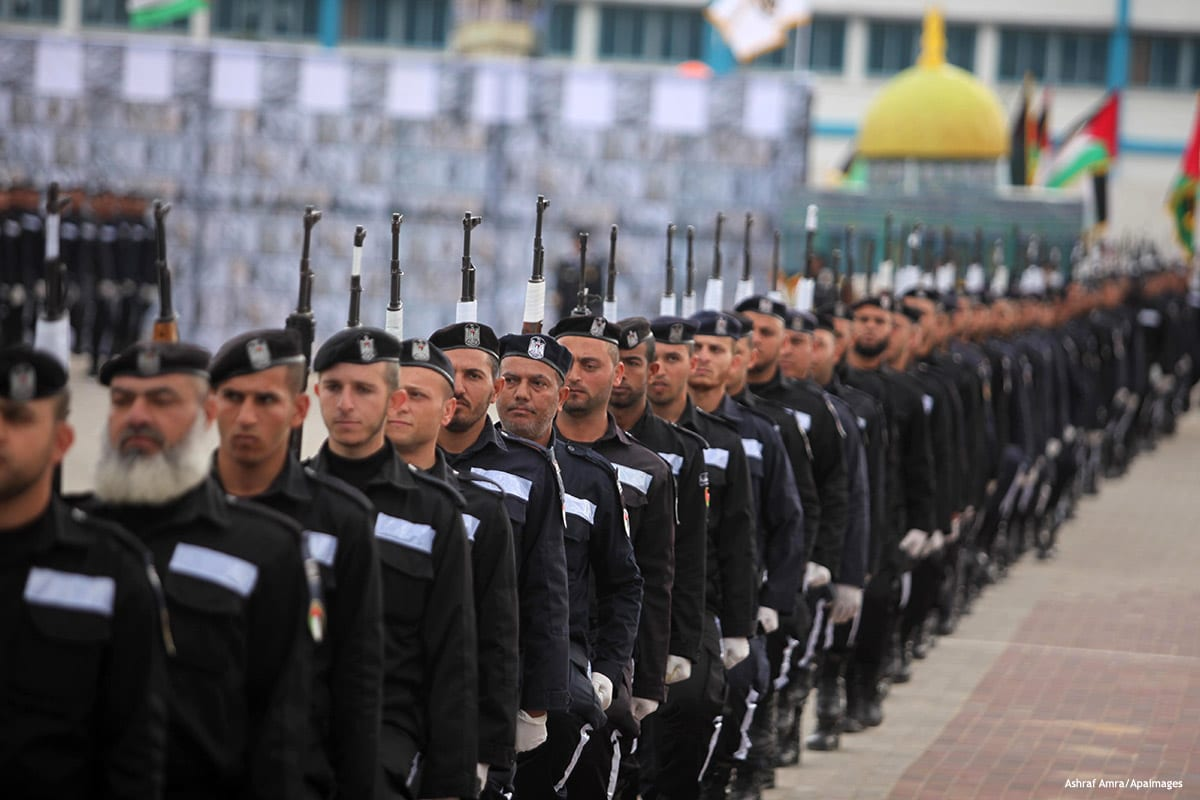 Palestinian policemen march during a graduation ceremony in Gaza City on January 21, 2017.