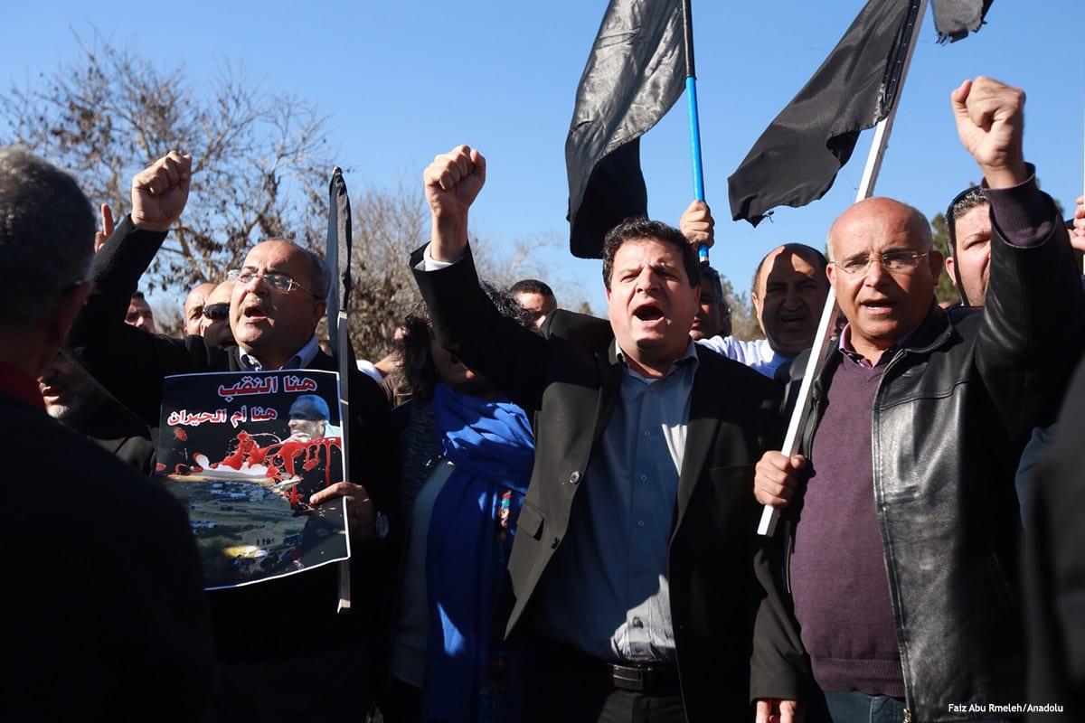 Palestinians demonstrate against Israeli violations in front of the Knesset building in Jerusalem on 27 January 2017 [Faiz Abu Rmeleh/Anadolu Agency]