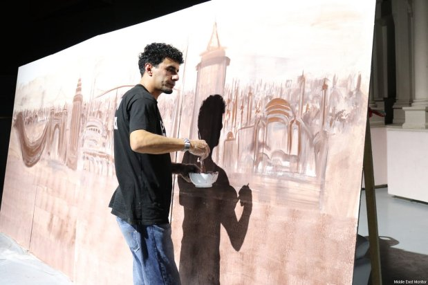 An artists works on his art installation at the Palestinians Abroad conference in Istanbul, Turkey on February 25, 2017 [Middle East Monitor]