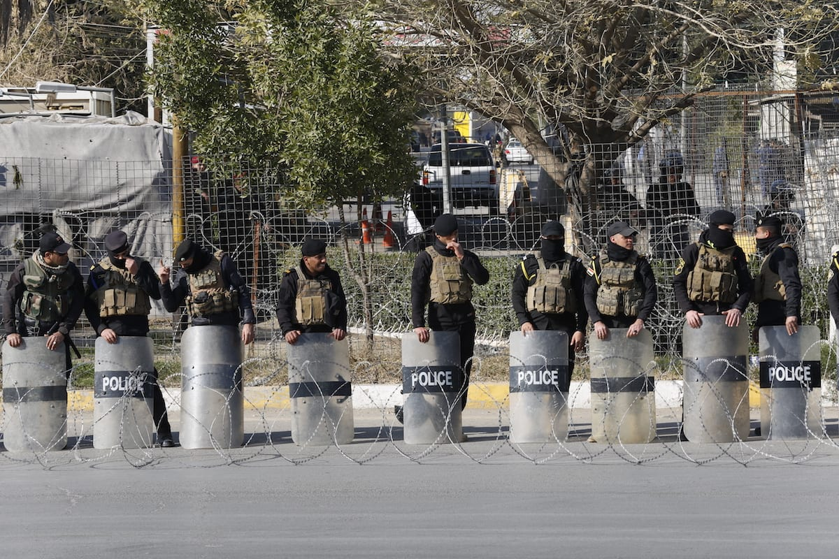 Police take security measures as supporters of Shiite cleric Muqtada al-Sadr stage a protest, in Baghdad, Iraq on February 08, 2017. [Murtadha Sudani - Anadolu Agency]