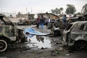 BAGHDAD, IRAQ - FEBRUARY 17: People inspect the wrecked cars a day after a car bomb attack at al-Bayaa auto gallery in capital of Baghdad, Iraq on February 17, 2017. Many casualities reported after the attack. ( Murthadha Sudani - Anadolu Agency )