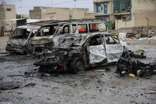 BAGHDAD, IRAQ - FEBRUARY 17: Wreckage of cars are seen a day after a suicide car bomb attack at al-Bayaa auto gallery in capital of Baghdad, Iraq on February 17, 2017. Many casualities reported after the attack. ( Murthadha Sudani - Anadolu Agency )