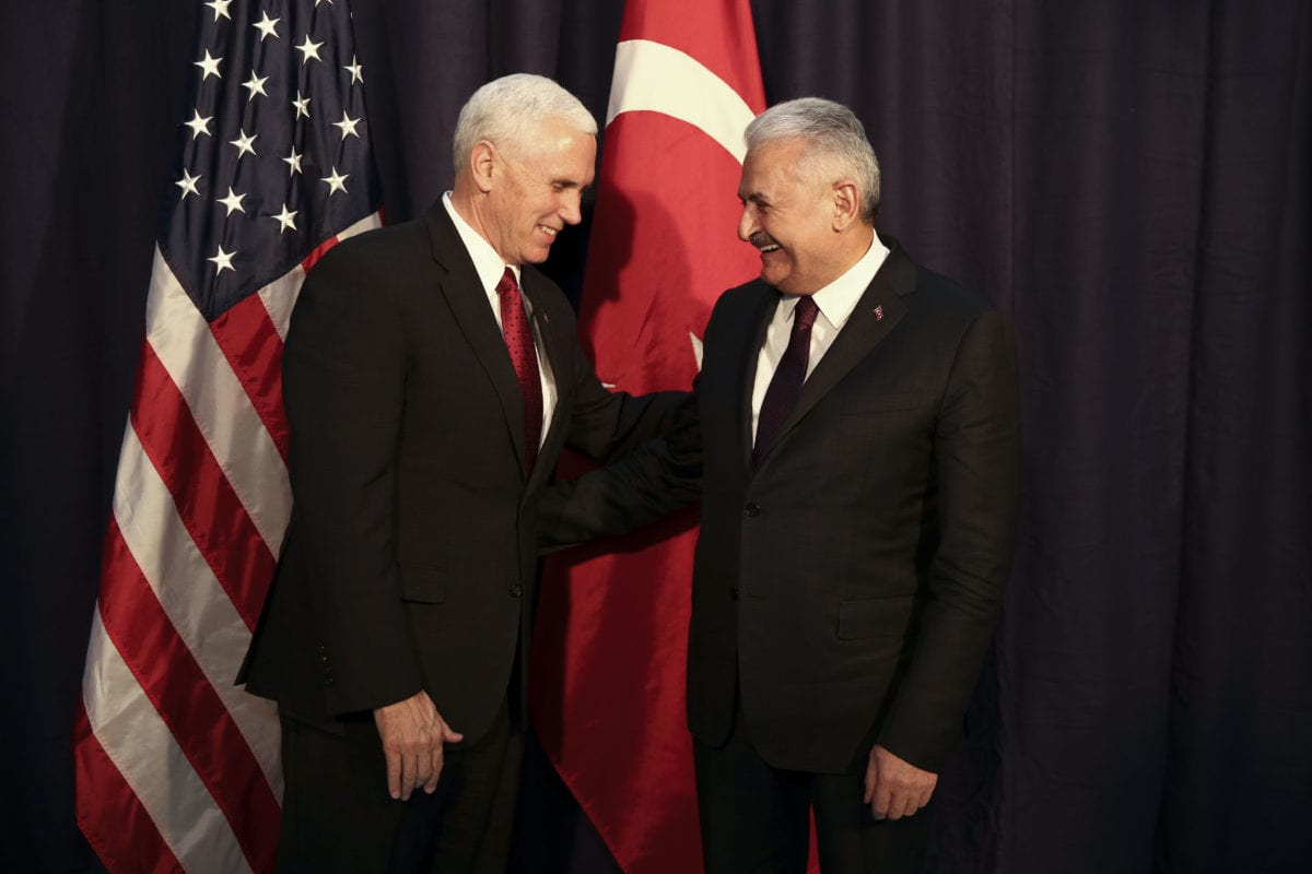 US Vice President Michael Richard Pence (L) and Turkish Prime Minister Binali Yildirim pose for a photo before their meeting on the second day of the 53rd Munich Security Conference (MSC) at the Bayerischer Hof hotel in Munich, Germany on February 18, 2017 [Güven Yılmaz / Anadolu Agency]