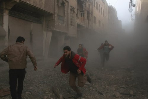 Image of Syrian civilians finding refuge after Assad Regime forces carried out airstrikes in Damascus, Syria on 15 February [Hamza Adnan - Anadolu Agency]