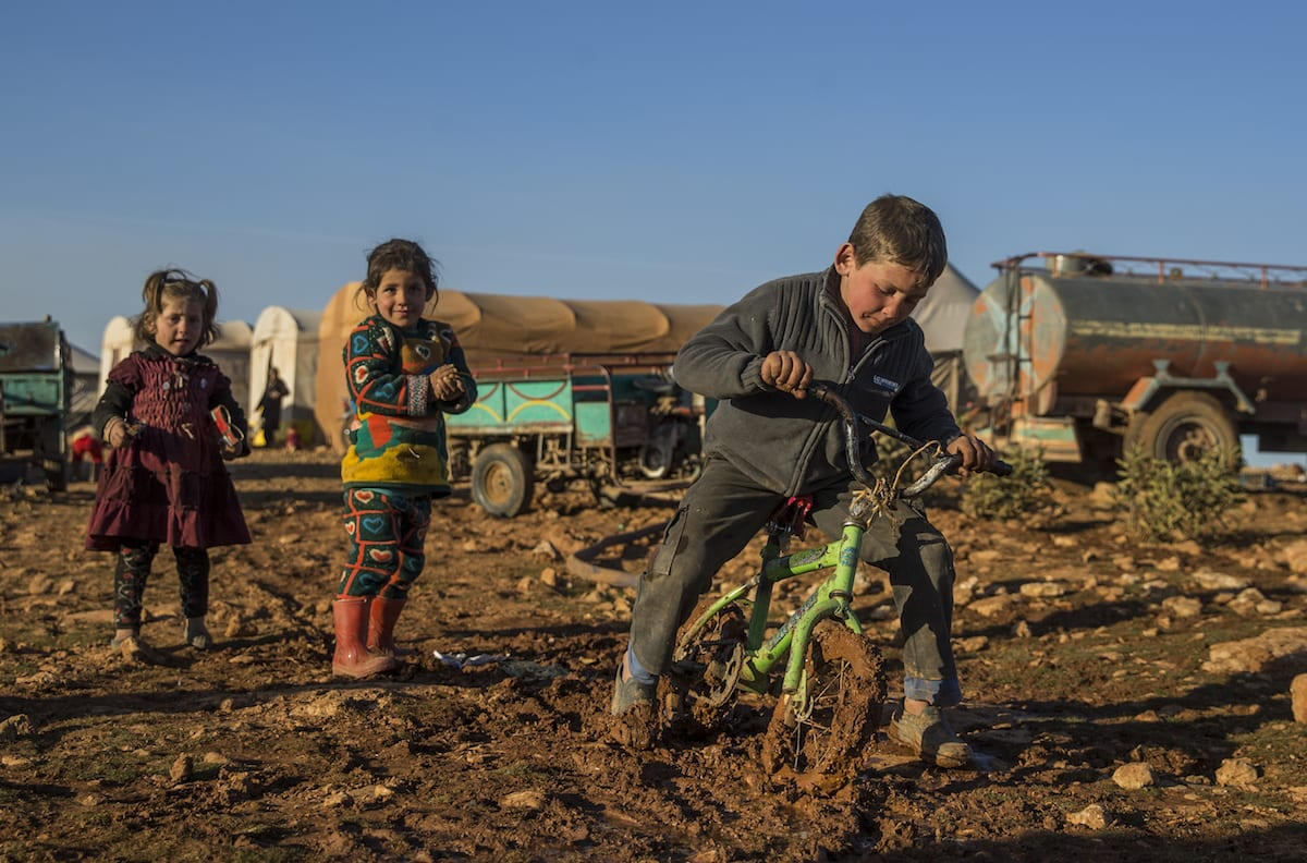 Internally displaced children, who fled from al Bab district of Aleppo due to Daesh, play as they take shelter in the opposition controlled Susanbat village near the al Bab district in Aleppo, Syria on 19 February 2017. [Emin Sansar - Anadolu Agency]