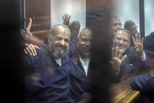 Vice chairman of the Freedom And Justice Party Mohamed Beltagy (L), Senior political figures of the Muslim Brotherhood Saad El-Katatni (C) and Vice chairman of the Freedom And Justice Party Essam el-Erian (R) gesture during a trial session over the Wadi el-Natrun prison case at Cairo Police Academy in Egypt on February 26, 2017 [Moustafa El Shemy/Anadolu Agency]