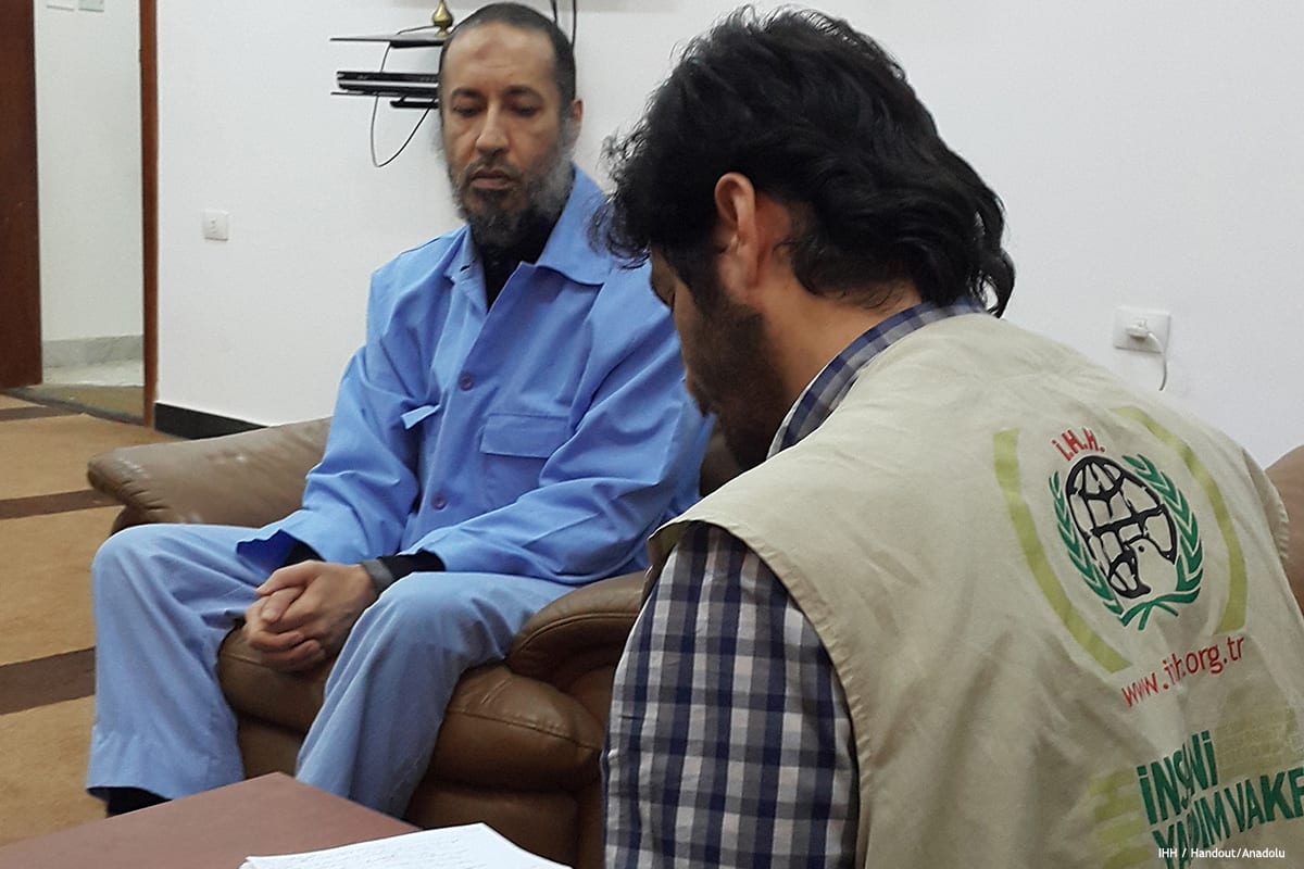 A member of the Foundation for Human Rights and Freedoms and Humanitarian Relief (IHH) meets with Saadi Gaddafi (L), late Libyan leader Muammar Gaddafi's son during their visit at Al-Hadba prison, in Tripoli, Libya on 23 February 2017 [IHH/Anadolu]