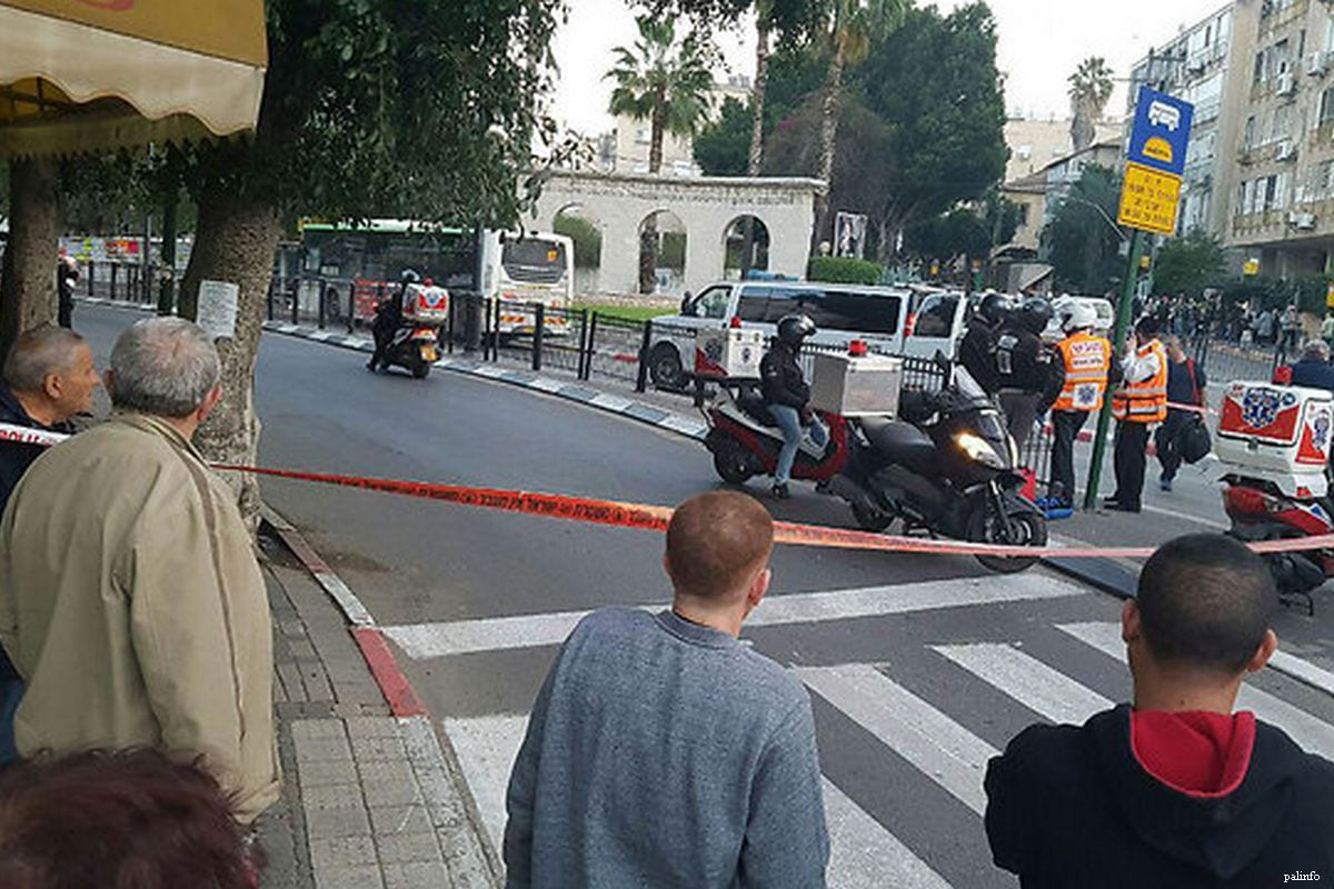 Image of Israeli police and by standers at the scene of an alleged shooting in Israel