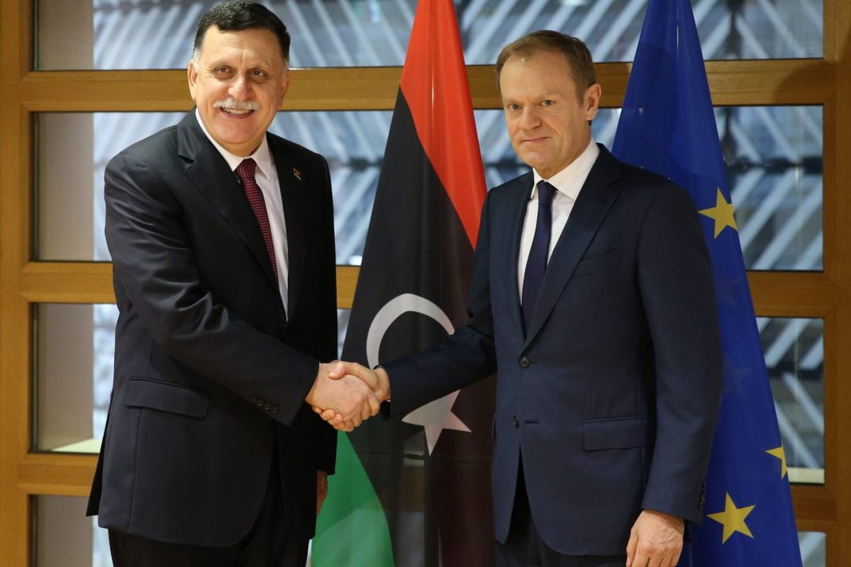 BRUSSELS, BELGIUM: Chairman of the Presidential Council of Libya Fayez Al-Sarraj (L) shakes hands with European Council President Donald Tusk (R) ahead of their meeting in Brussels, Belgium on 2 February 2017. [Dursun Aydemir/Anadolu Agency]