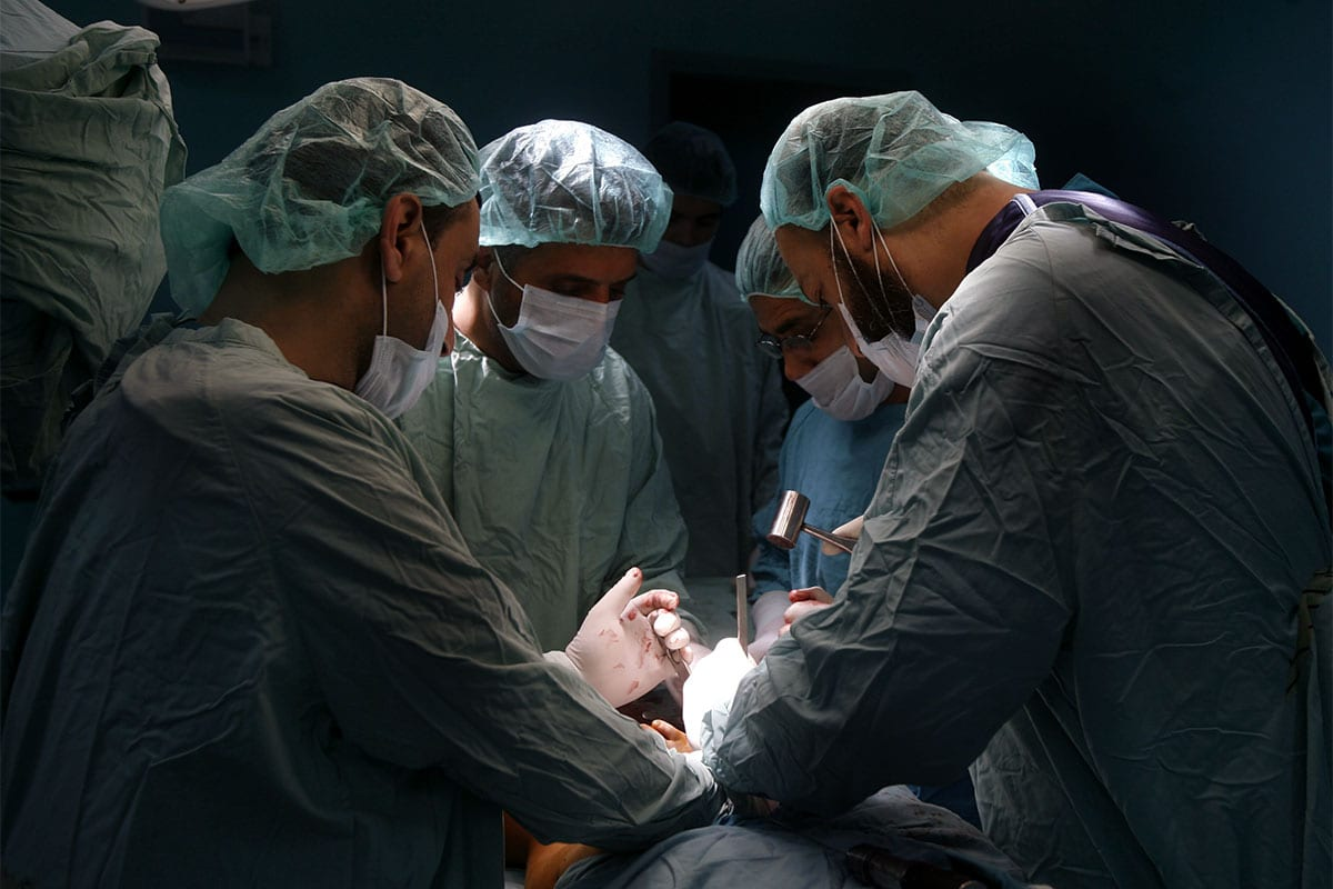 File photo of Palestinian doctors performing a surgery at the Abu Yousef Al Najjar hospital in Rafah city, Gaza Strip, on April,15, 2012 [Eyad Al Baba / ApaImages]