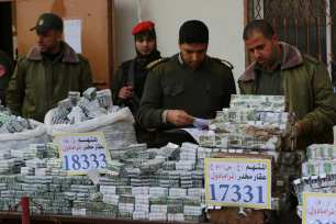 Police hold a press conference in Gaza after a major drugs bust. The two traffickers responsible for these drugs were sentenced to death on March 19, 2017 [Mohammed Asad / Middle East Monitor]