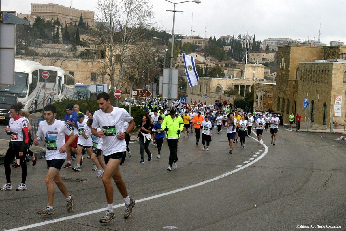 Image of a marathon taking place in the Old City of Jerusalem [Mahfouz Abu Turk/Apaimages]
