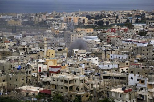 Smoke rises within the clashes between Fatah movement members and some Palestinian Islamic groups at Ain al-Hilweh refugee camp in Lebanon's southern port city of Sidon on 28 February 2017 [Ratib Al Safadi - Anadolu Agency]