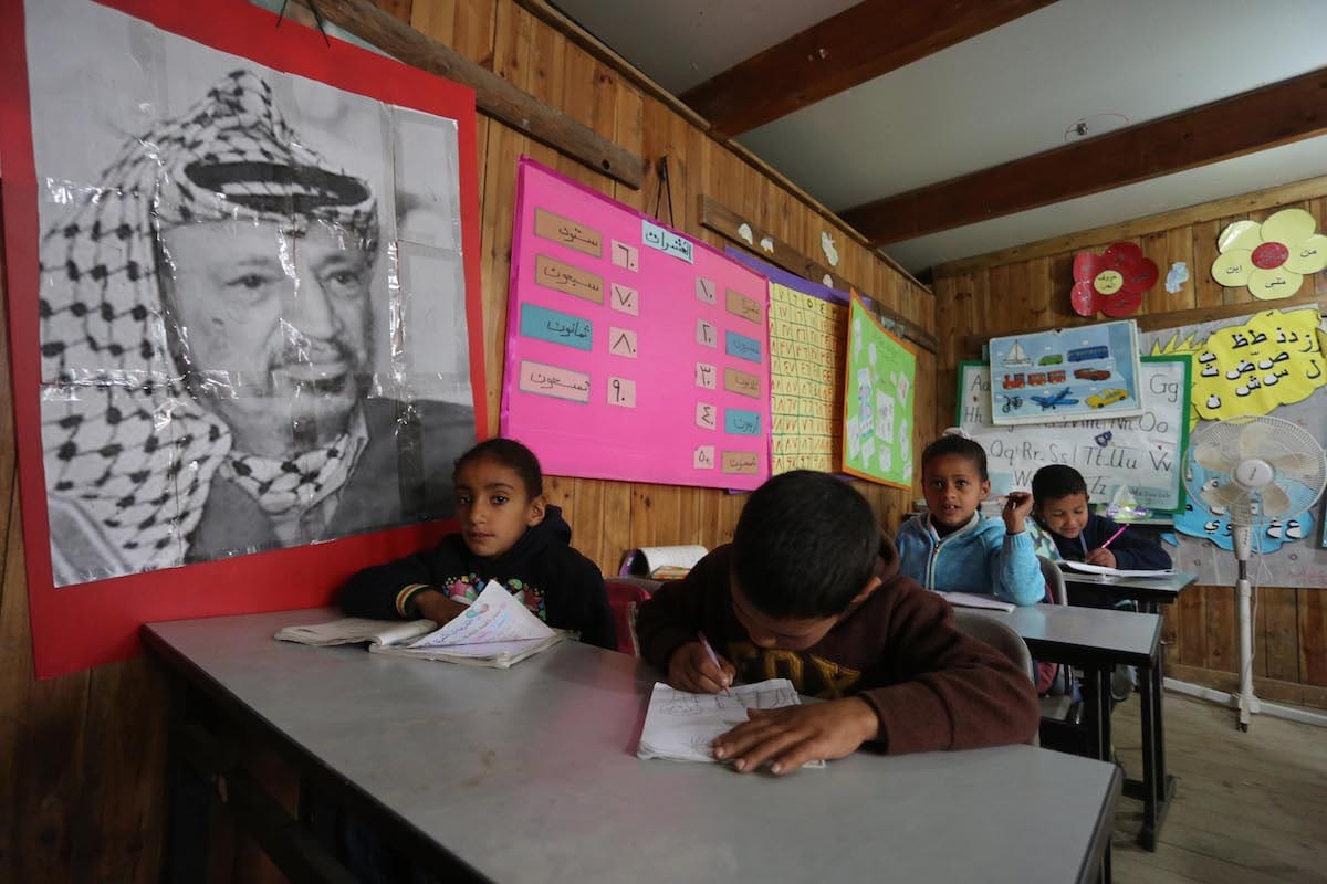 Palestinian students are seen into a classroom of a primary school named Khan al-Ahmar which faces Israeli demolition on the grounds that being unlicensed during a visit of the Palestinian Prime Minister Rami Hamdallah (not seen), in Jerusalem on March 02, 2017. ( Issam Rimawi - Anadolu Agency )