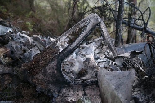 A part from the wreckage of a Syrian military plane is seen after it crashed near Turkey-Syria border in Hatay, Turkey on March 5, 2017 [Cem Genco / Anadolu Agency]