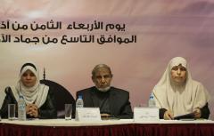 GAZA CITY, GAZA - MARCH 8: One of the leaders of Hamas Mahmoud al-Zahar (C) and Reca el-Halebi, a member of Hamas' women branch, attend an event organized for the International Women's Day in Gaza City, Gaza on March 8, 2017. ( Mustafa Hassona - Anadolu Agency )