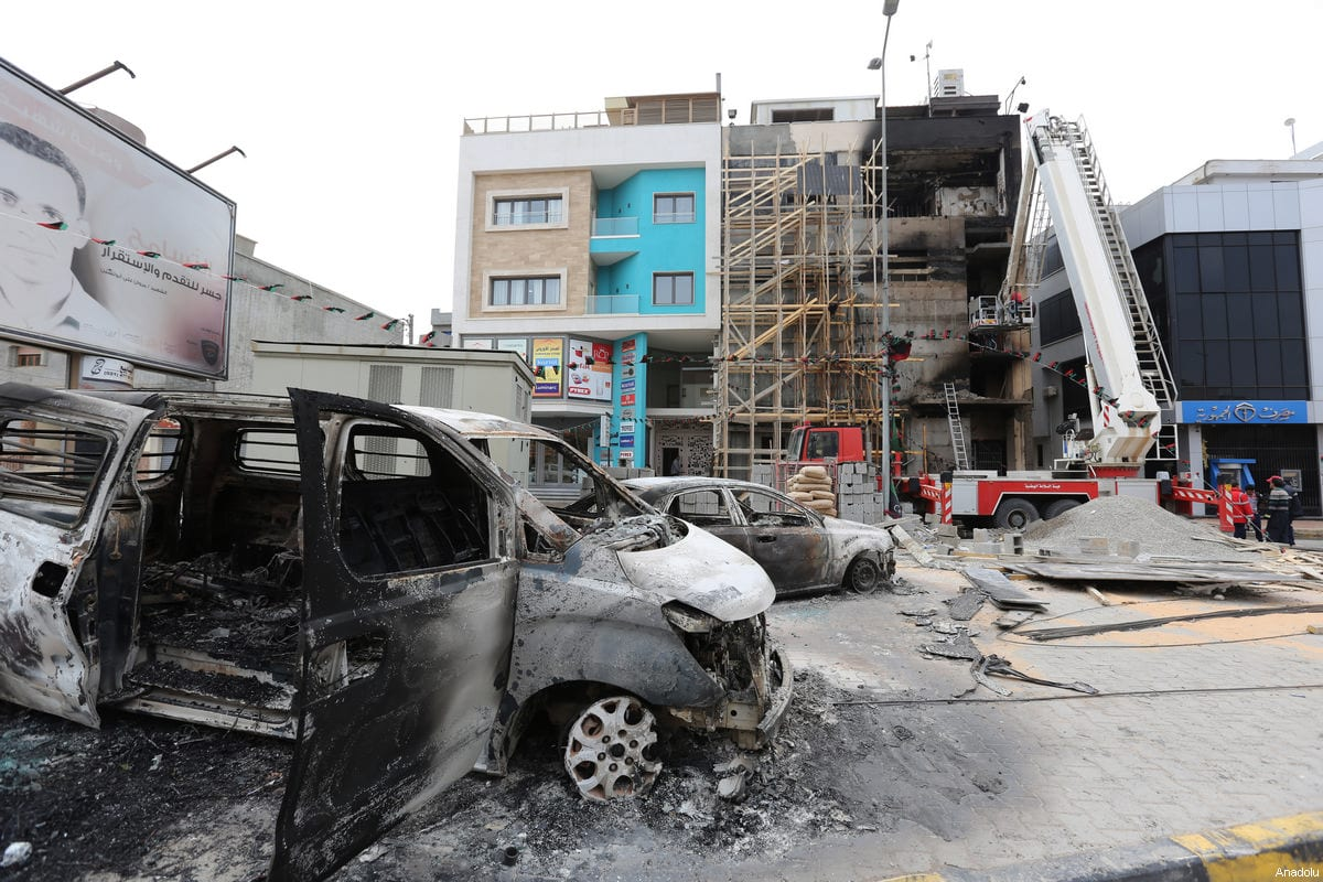 Burnt vehicles are seen after Tripoli-based salvation government's TV channel was burned down by a group of gunmen in Tripoli, Libya on March 15, 2017 [Hazem Turkia / Anadolu Agency]