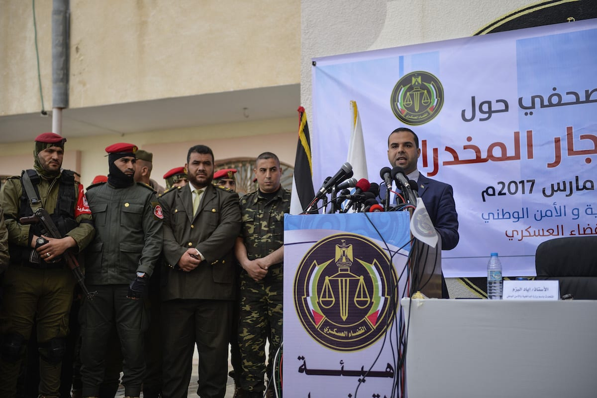 Gazan Interior Ministry Spokesman Iyad al-Buzum delivers a speech during a press conference at court-martial house after court-martial sentenced two defendants, who were on trial for drug trafficking, to death penalty in Gaza City, Gaza on 19 March 2017. [Mustafa Hassona - Anadolu Agency]
