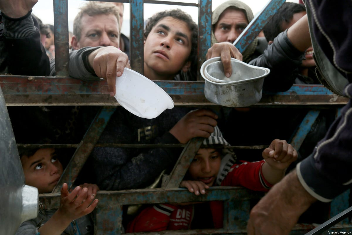 Iraqi civilians take refuge at a refugee camp as the operation to retake Iraq's Mosul from Daesh terrorists continues in Mosul, Iraq on March 19, 2017. ( Yunus Keleş - Anadolu Agency )