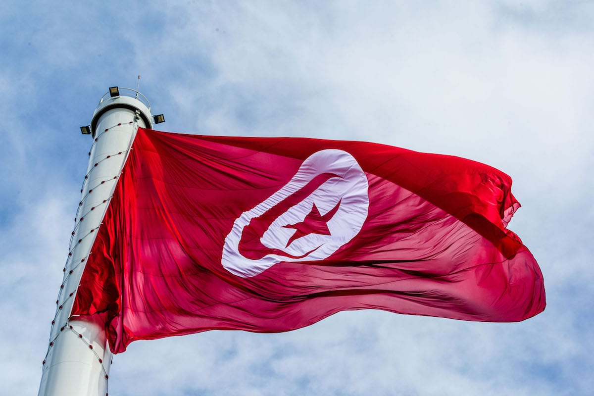 Tunisian flag is raised up to the highest flagpole on the 61st anniversary of Tunisia's independence in Tunis, Tunisia on 20 March 2017 [Amine Landoulsi/Anadolu Agency]