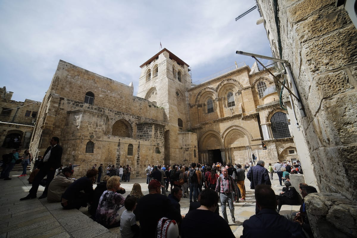 People gather outside of the Church of the Holy Sepulchre which was opened to worship after the restoration in Jerusalem on 22 March, 2017 [Mostafa Alkharouf/Anadolu Agency]