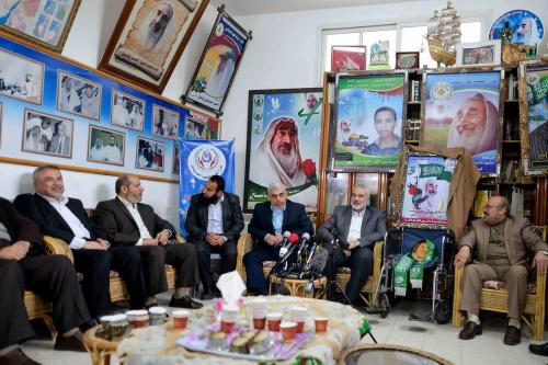 Senior political leader of Hamas, Ismail Haniyeh (R 2) and new leader of Hamas in Gaza, Yahya Es-Sinvar (R 3) attend a ceremony to mark the 13th death anniversary of founder of Hamas Sheikh Ahmed Ismail Hassan Yassin in Gaza City, Gaza on 22 March, 2017 [Hassan Jedi/Anadolu]