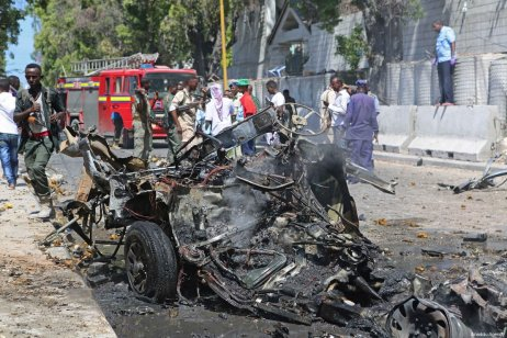 MOGADISHU, SOMALIA: A damaged vehicle is seen at the explosion site after an attack staged with a bomb-laden vehicle near the Presidential Palace in Mogadishu, Somalia on March 24, 2017. [Sadak Mohamed/Anadolu Agency]