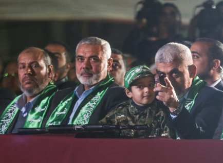 Leader of Hamas in the Gaza Strip Yahya Sinwar (R) and senior political leader of Hamas Ismail Haniyeh (C) attend the memorial ceremony held for Mazen Fuqaha, who was killed by unknown persons, in Gaza City, Gaza on March 27, 2017. ( Mustafa Hassona - Anadolu Agency )