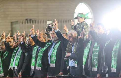 Leader of Hamas in the Gaza Strip Yahya Sinwar (3rd R) and senior political leader of Hamas Ismail Haniyeh (4th R) attend the memorial ceremony held for Mazen Fuqaha, who was killed by unknown persons, in Gaza City, Gaza on March 27, 2017. ( Mustafa Hassona - Anadolu Agency )