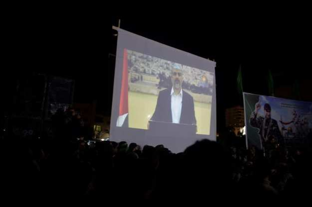 The Head of the Hamas Political Bureau, Khaled Meshaal, broadcast a message last week to the audience at the memorial ceremony in Gaza for Mazen Fuqaha, who was killed by unknown assassins in the coastal enclave on 24 March 2017. ( Mustafa Hassona - Anadolu Agency )