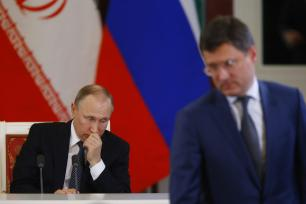 Russia's Energy Minister Alexander Novak (R) is seen as Russian President Vladimir Putin (rear) and Iranian President Hassan Rouhani (not seen) hold a joint press conference following their meeting in Moscow, Russia on March 28, 2017. ( Sefa Karacan - Anadolu Agency )